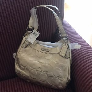 NWT COACH SOHO LOGO IN GOLD